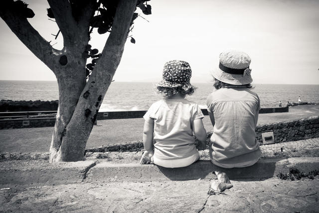 2kids enjoy the view of the beach